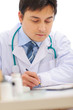 Medical doctor working at office