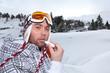Portrait of a skier applying lip balm
