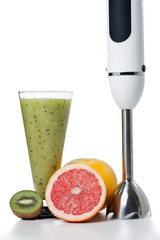 Smoothie and fresh fruits with blender