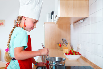 girl cooking in modern kitchen