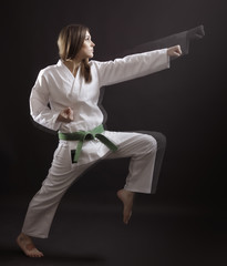 woman - a master of karate performs a straight punch.