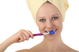young healthy woman in a towel cleans teeth with a toothbrush