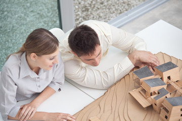 Architects working on a house maquette