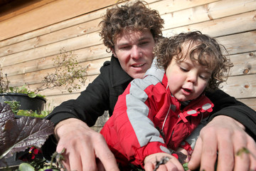 Little boy gardening with father