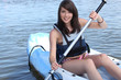 Teenage girl in row boat
