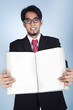 Businessman with blank book