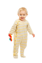 Smiling kid standing with rattle on white background