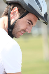 a man wearing a bike helmet