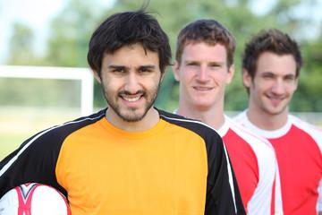 Three football players