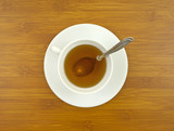 Ginseng tea with spoon on tabletop poster
