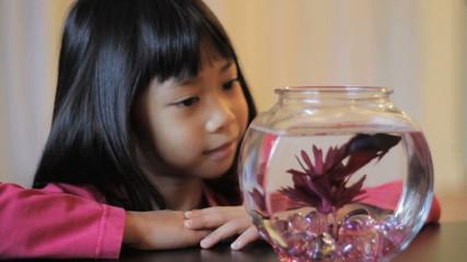 Girl Enjoying Her Red Betta Fish