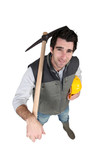 A manual worker with a pickaxe.