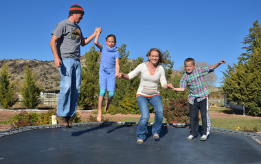 Family jumping on a trampoline