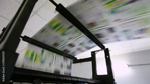 color newspaper production line during work