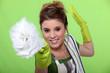 Fun woman doing household chores