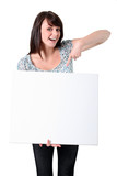 Cheerful woman pointing at a blank board