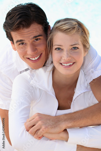 Young smiling couple dressed in white