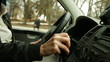 Woman behind the wheel in urban driving situations