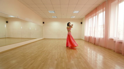 woman perform a belly dance in dancing school