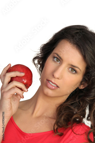 Woman displaying red apple
