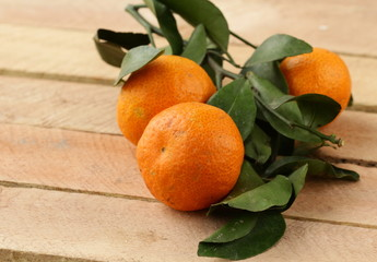 Fresh juicy tangerine, mandarin orange with leaves