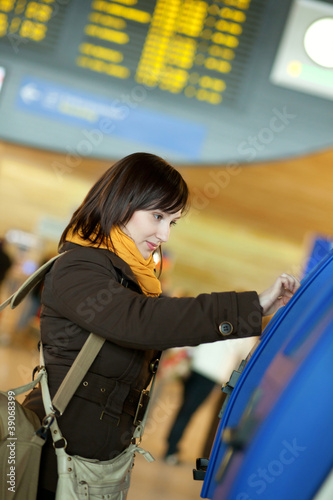 Girl doing self-checkin in the airport