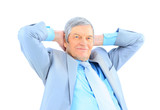 Nice businessman at the age, arms folded behind