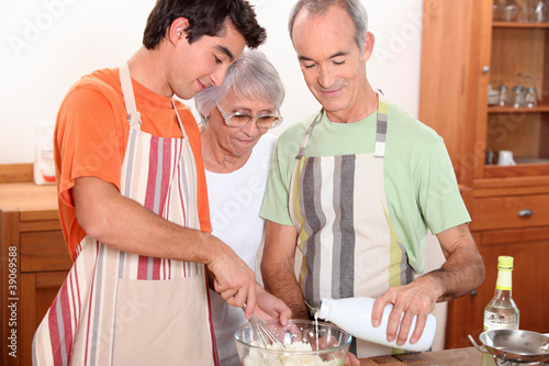 two men and woman making cake together