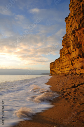 Golden sandstone cliffs at hive beach near Bridport Dorset.
