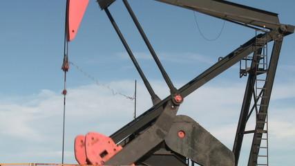 Oil pump against blue sky. . Sequence. Santa Cruz, Argentina