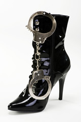Ladies Boots and handcuffs.