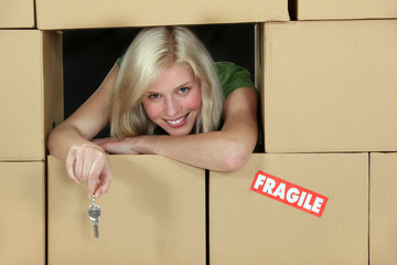 Woman surrounded by cardboard boxes