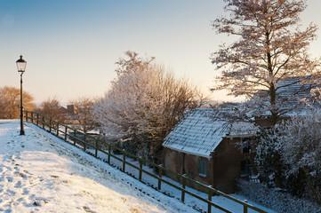 Snowy house down the Dutch dike