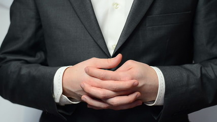 Businessman, hands nervously clasped