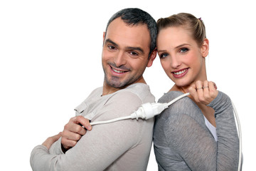 Couple holding electrical cable