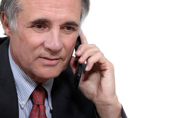 Older businessman with a cellphone