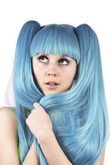 Young charming woman with blue hair looking up