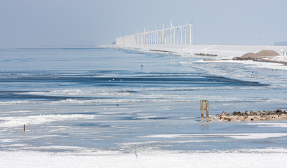 Dutch winter seascape with big farm of windturbines