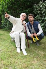 Senior pointing out something to gardener