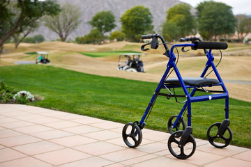 Walker Outdoors on Patio With Golf Course In Background
