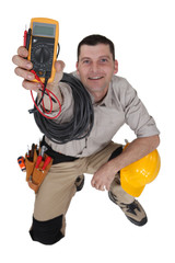 electrician holding a measurement tool