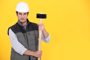 A construction worker with a sledgehammer.
