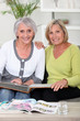 duo of grandmothers skimming through album