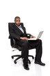 African American businessman sitting in chair with laptop