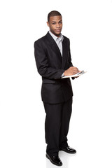 writing on clipboard - African American businessman