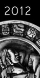 carved glyphs on a stone Mayan calendar with 2012 text poster