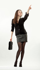 Young attractive businesswoman pointing at something