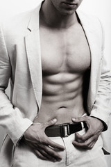Muscular man with sexy abs and suit