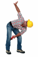 Construction worker with his arm up