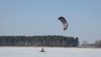 winter snow kiting on the lake ice